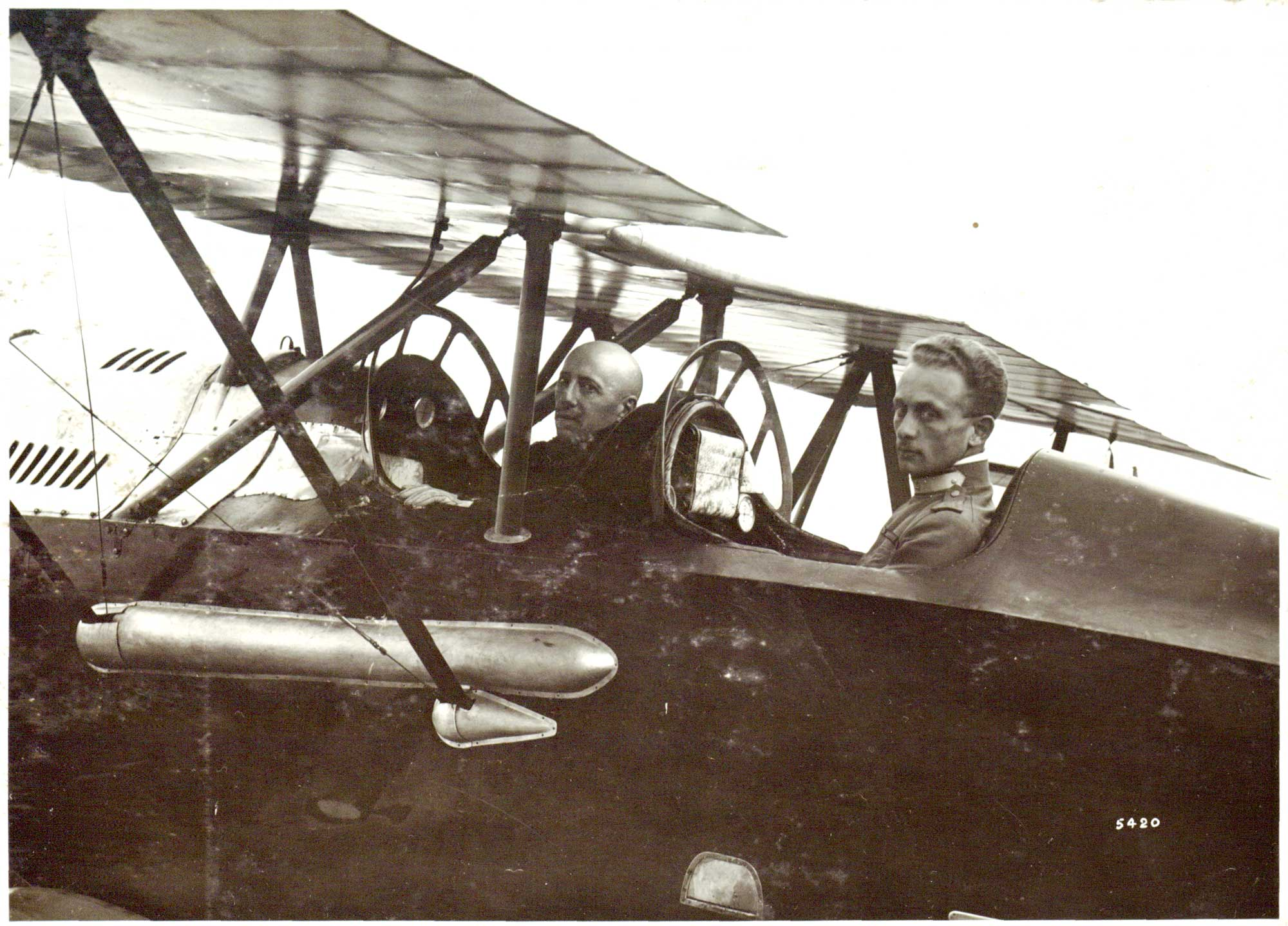 Photograph of Italian writer Gabriele d'Annunzio and pilot Natale Palli, prior to take-off. On 9 August 1918 they flew their aeroplane over Vienna, dropping thousands of leaflets and three large posters.