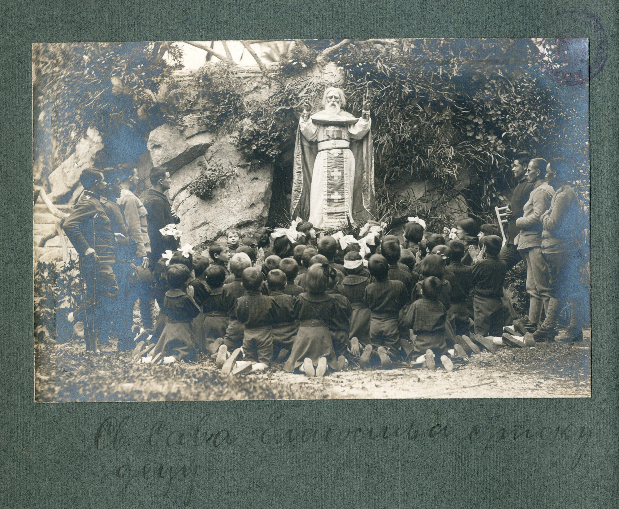 Serbian children praying in front of a statue of Saint Sava in an orphanage in Nice.