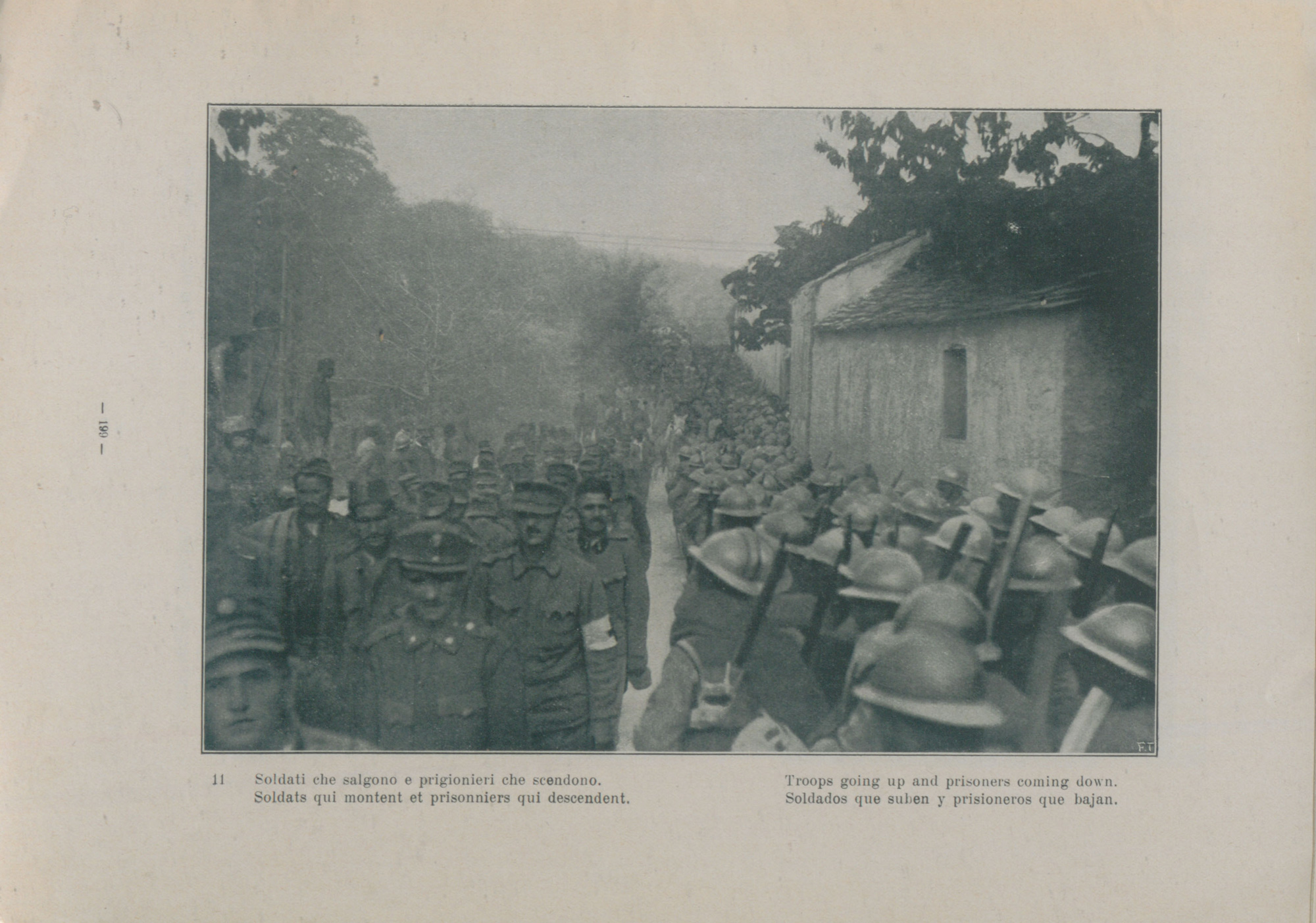 Italian photograph with the caption 'Soldiers going up and prisoners coming down', 1917.