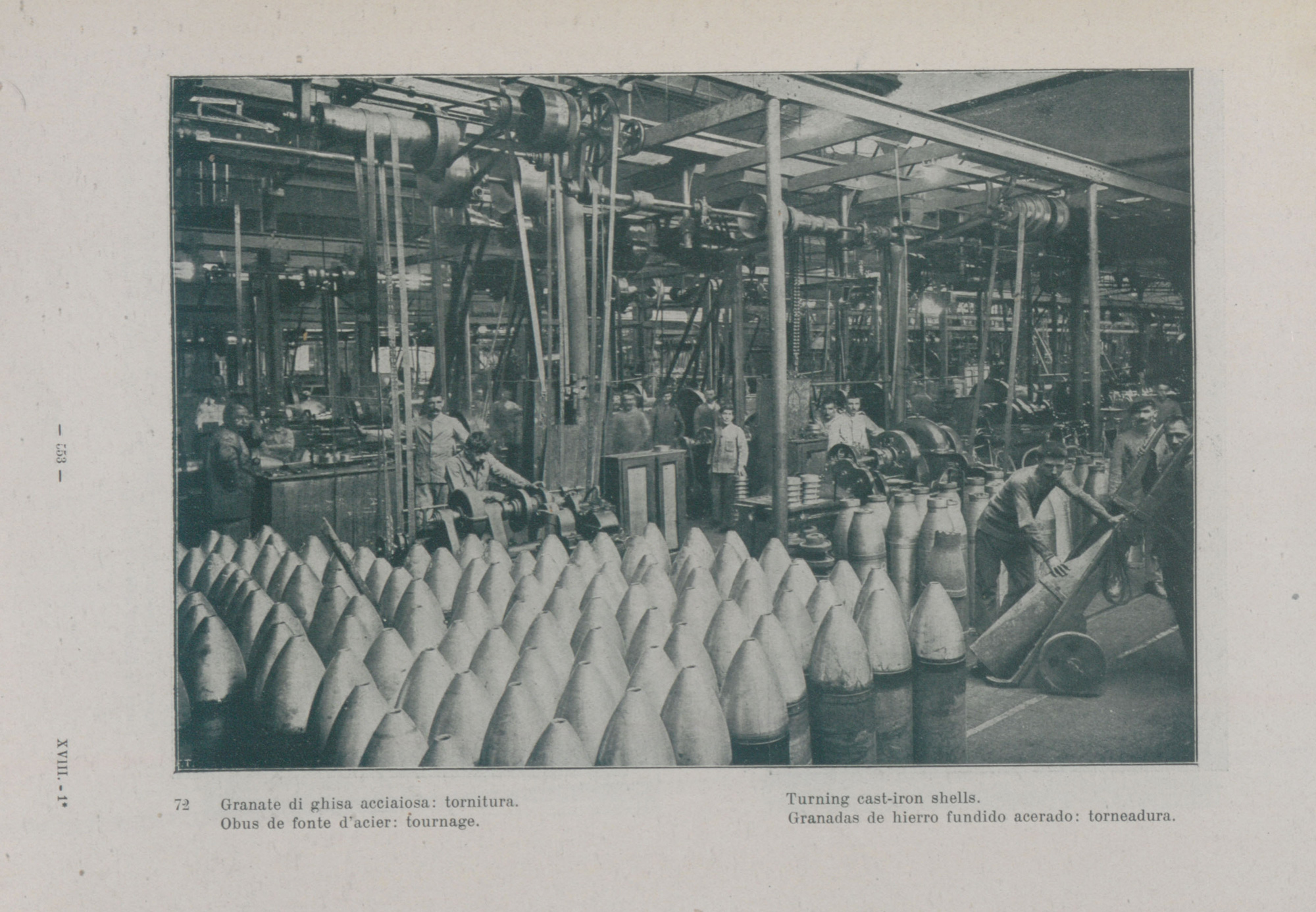 Photograph showing Italian workers - exempted from military service due to age or health reasons - making cast iron shells for bombs in a munitions factory.