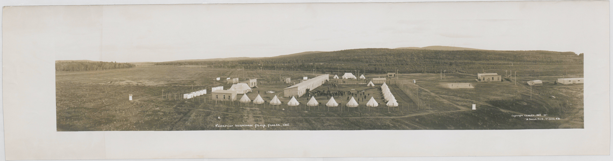 Photograph, 1915, showing Valcartier internment camp. Valcartier, near Quebec City, was originally built as a military training camp, but was also used as a internment camp for 'enemy aliens' during World War One.