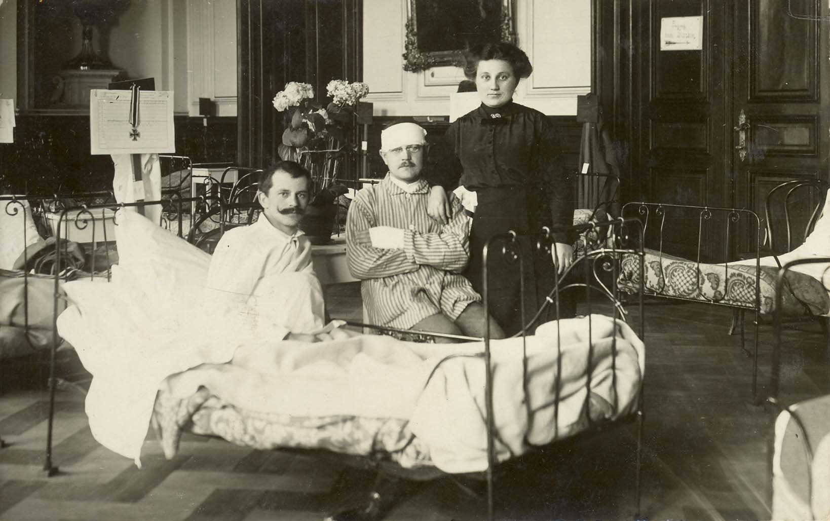 Two wounded German soldiers convalescing at Strasbourg, one of them displaying the Iron Cross.