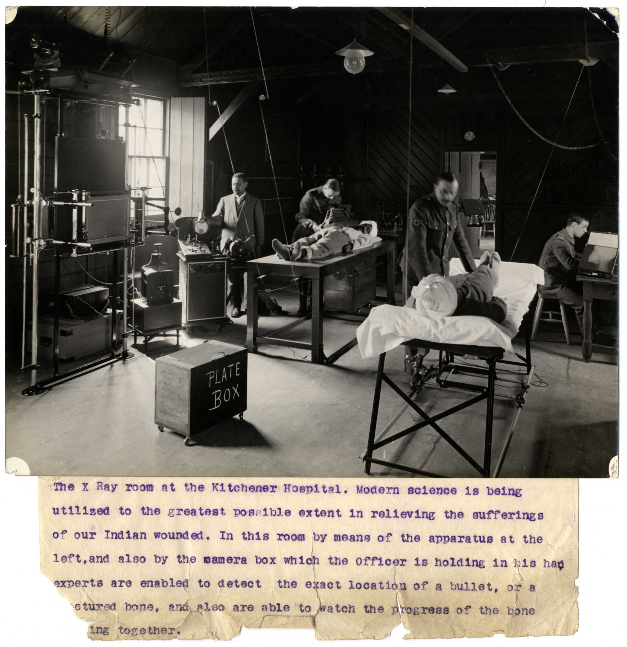 Two wounded Indian soldiers are given x-rays at the Kitchener Indian Hospital in Brighton, 1915.
