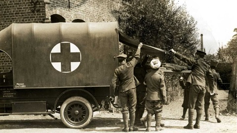Banner for medicine theme, black and white photograph showing stretcher bearers unloading a patient from an ambulance truck