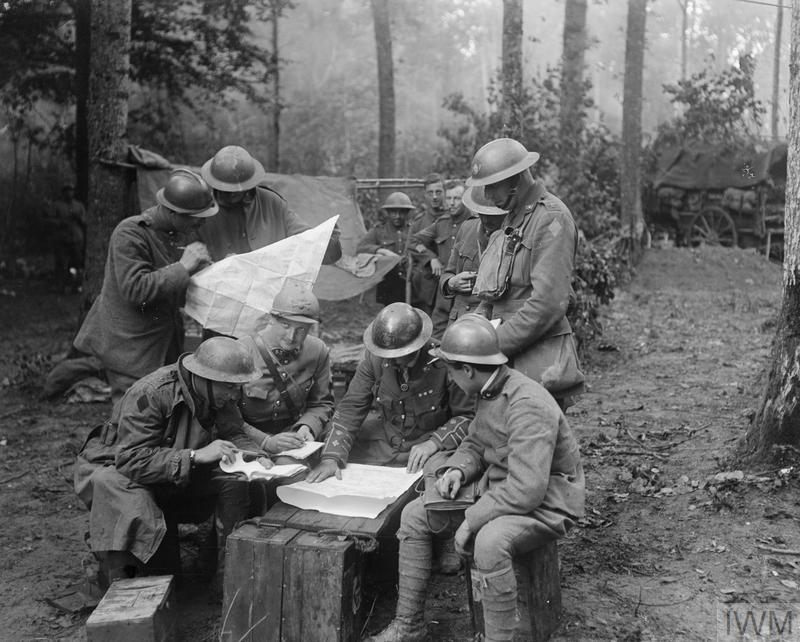 Officers of the 2nd Battalion, King's Own Yorkshire Light Infantry, 62nd Division, conferring with French and Italian officers in the Bois de Reims during the Battle of Tardenois, 24 July 1918.