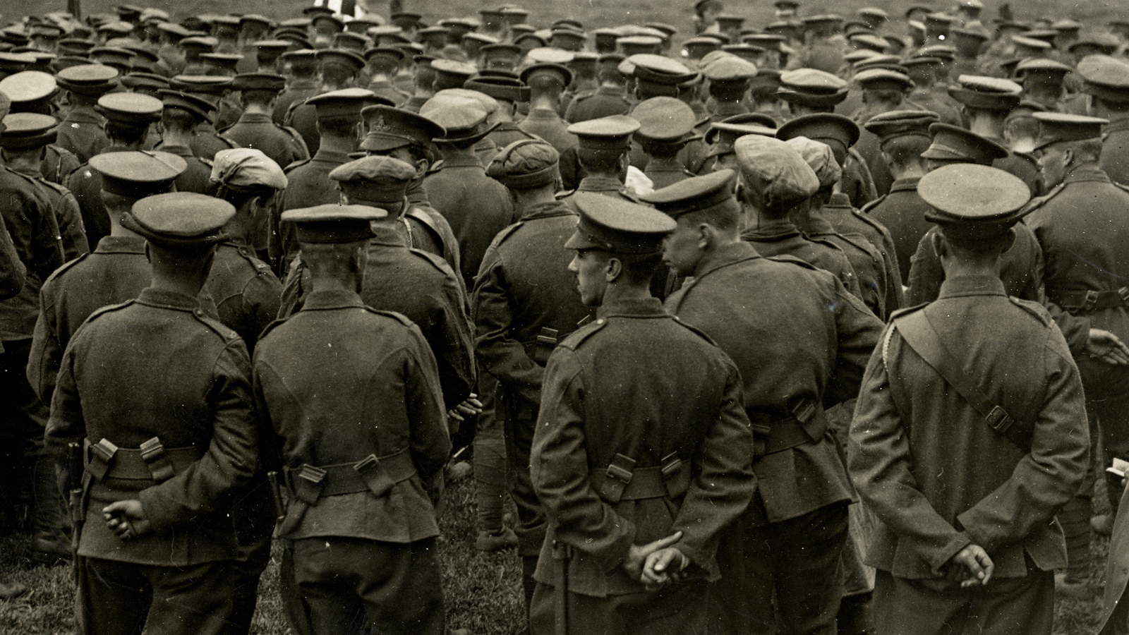 Photograph showing a large group of soldiers attending a church service in a field