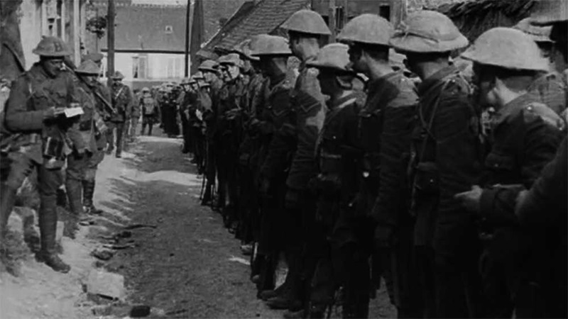 Still image from film footage of the Battle of the Somme showing soldiers standing in two lines