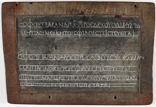 A 2nd-century wax tablet featuring a writing exercise in Ancient Greek.