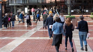 People walking towards the main entrance of the British Library