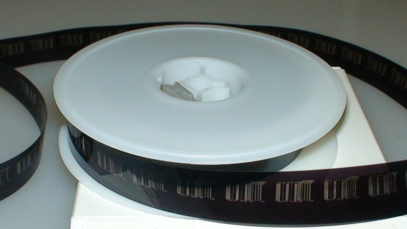 A microfilm roll of negative/COM Output.