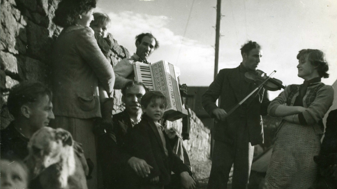 Albert Stewart (fiddle) and unidentified accordionist with other Stewart family members.