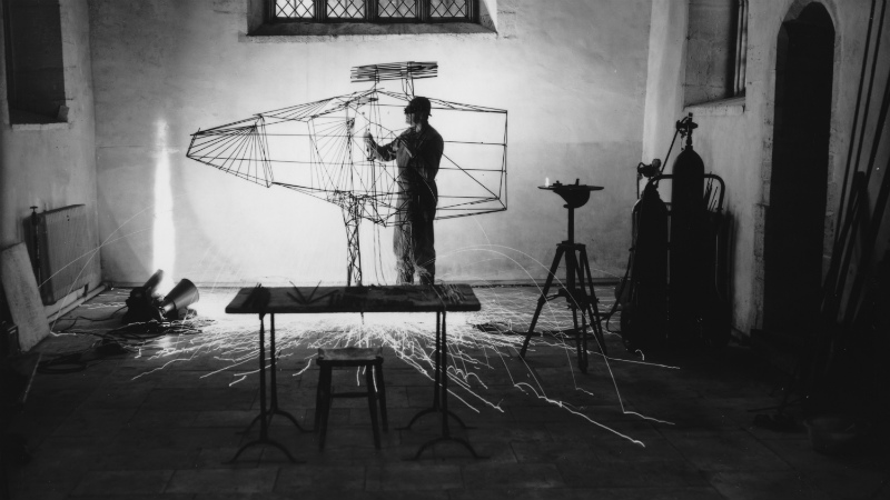 Lynn Chadwick welding the armature for Stranger III in the chapel at Lypiatt Park