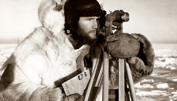 Charles Swithinbank surveying deformation of the ice shelf at Maudheim, Antarctica, 1950