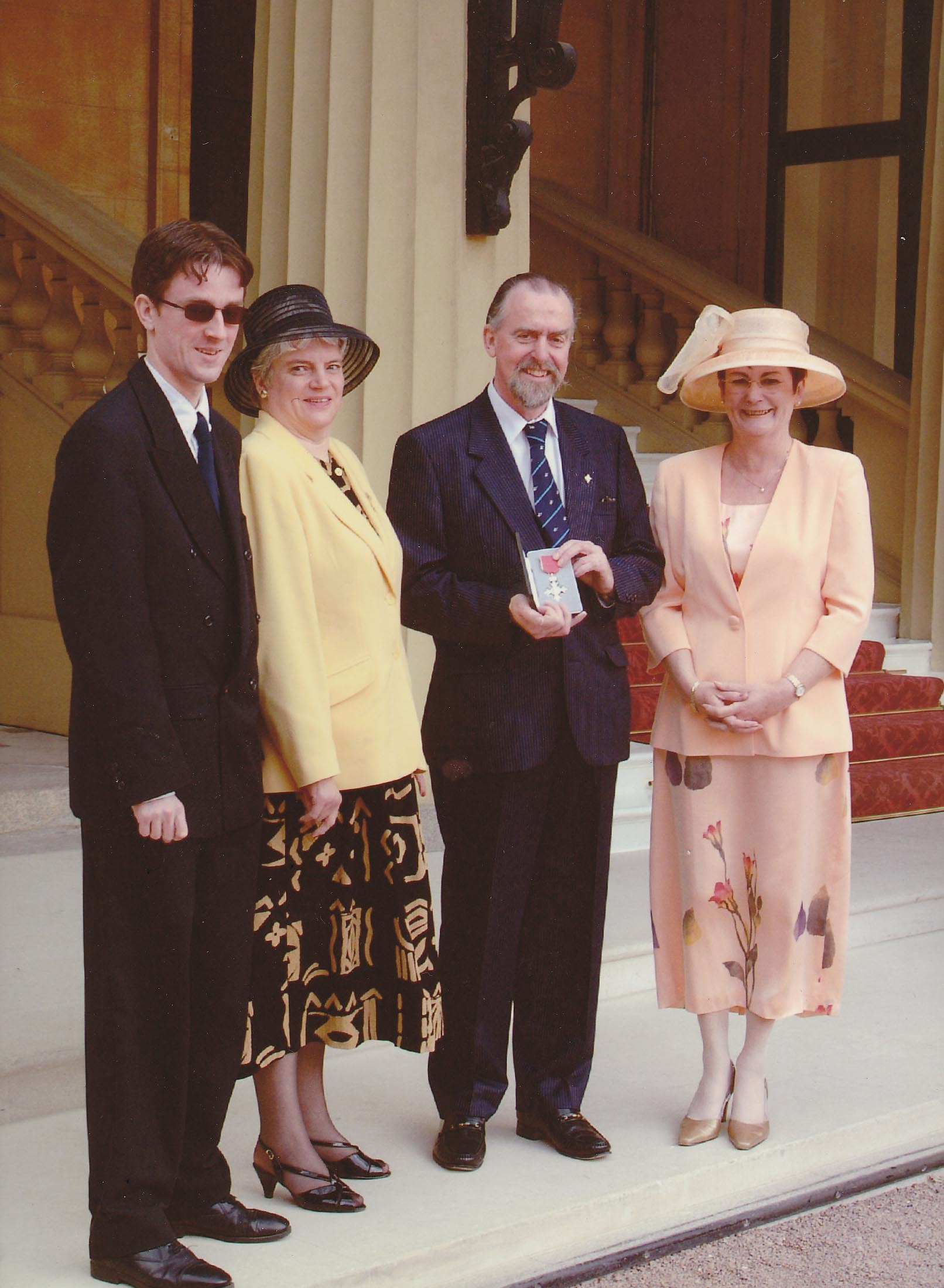 Bob Parkinson on receiving his MBE with familyat Buckingham Palace, 2002