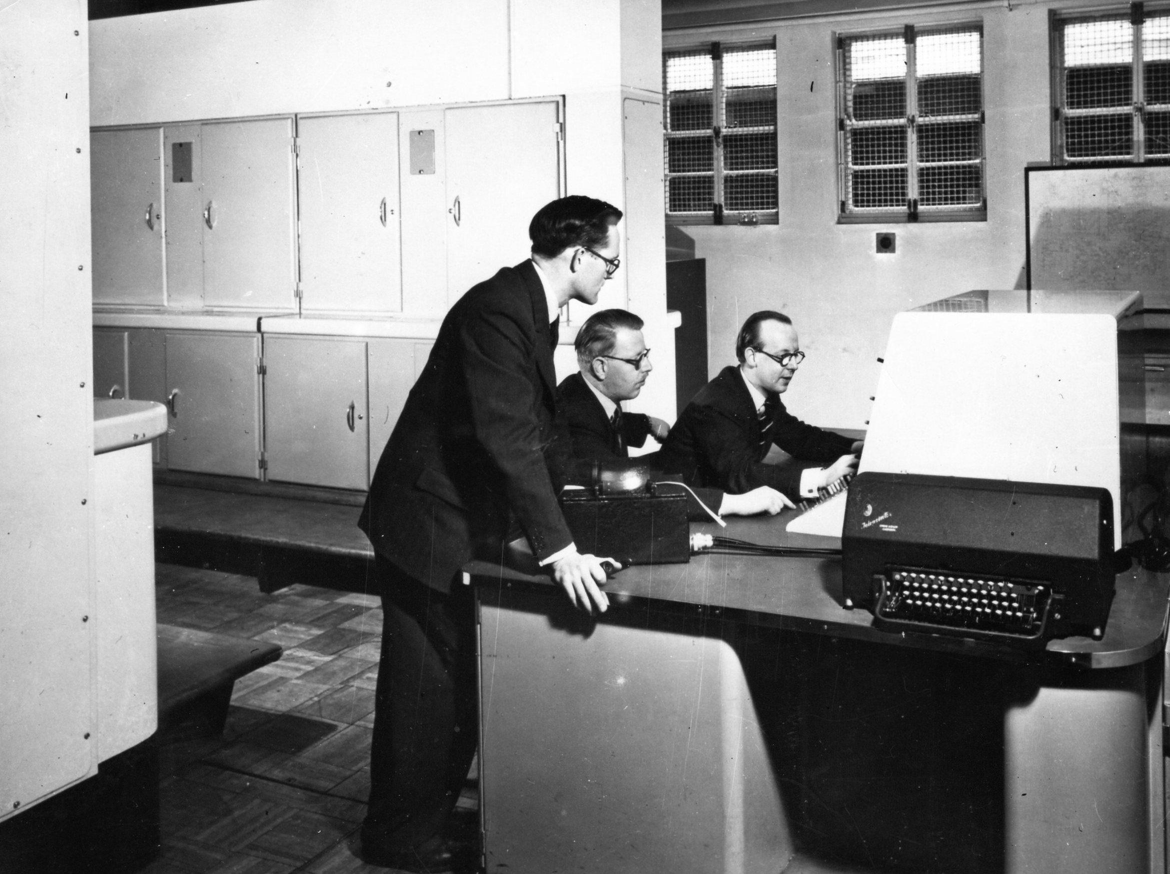 Tom Kilburn, Keith Lonsdale and Brian Pollard with Mark 1 computer, 1951