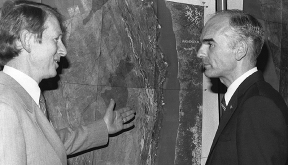 Anthony Laughton discusses map of US Exclusive Economic Zone with Don Hodel, Secretary of the Interior, mid 1980s