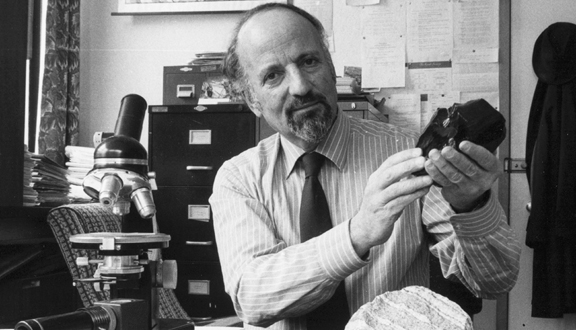 Stephen Moorbath with sample of 3800 million year old rock from Greenland at the University of Oxford, 1983