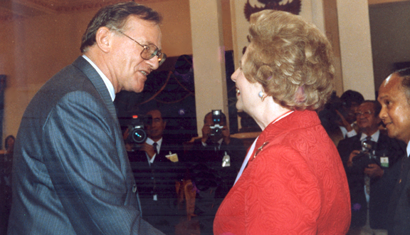 John Coplin shaking hands with former British Prime Minister Margaret Thatcher, 1992