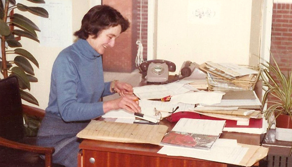 Mary Almond at her desk at the University of Manchester, 1970s