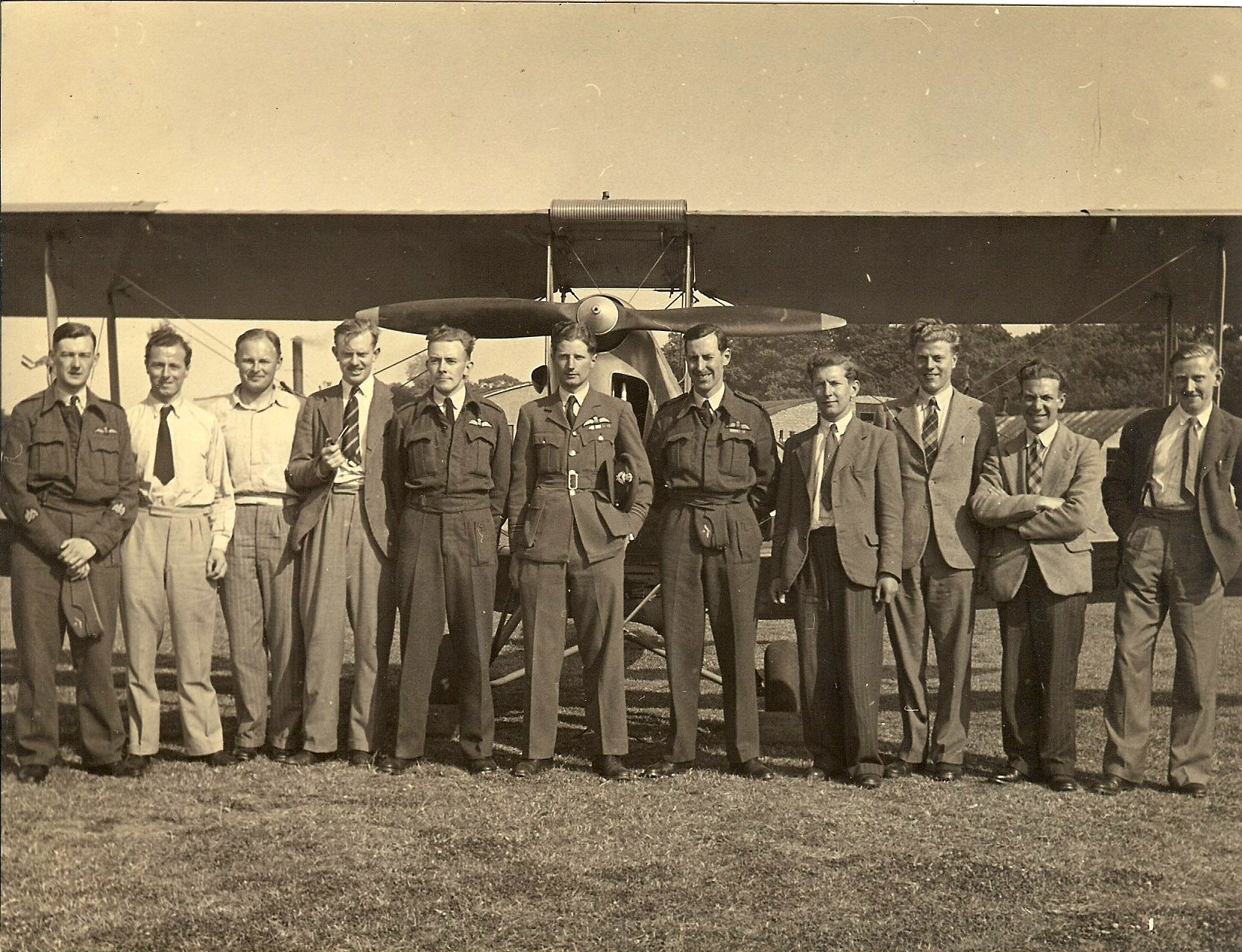 Dennis Higton (3rd from right) and colleagues with an aeroplane, c.1940s