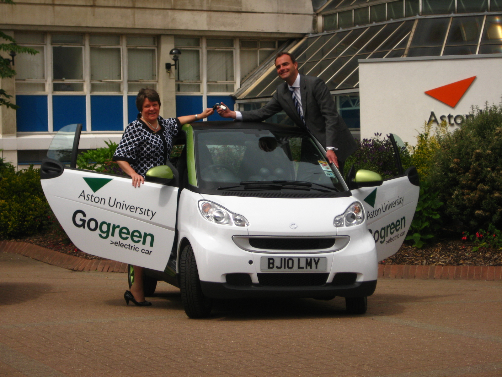 Professor Dame Julia King with electric car.  Photo Aston University