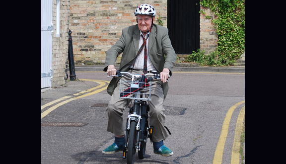Alan Cottrell on an electric bicycle