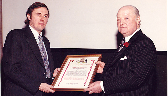 Sir John Davies (right) presenting George Hockham with the Rank prize, 1978
