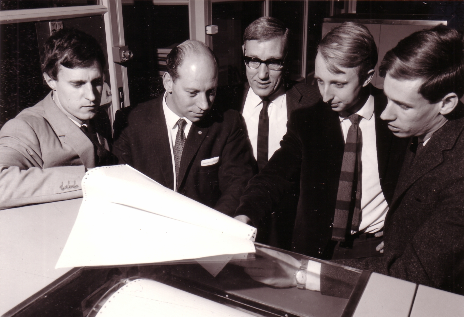 Tom Jackson (centre) with colleagues at the Standard Telecommunications Laboratory